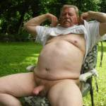 Horny old man getting naked outdoors