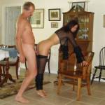 "Candi Annie bends over to receive Al's cock all the while posing for the camera!  Asking, ""Do you like what you see""?"