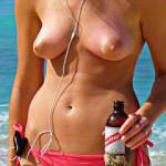 Wife letting her all natural titties and big nipples out on the beach for all to enjoy.