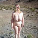 Becky gets some sun on her juggs in the desert.