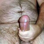 Me masturbating with a glub of cumstreaming down the side of my cock.