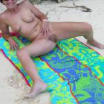 Showing off my pussy again at another public beach.