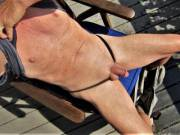 lying out in the sun showing off for you,