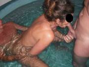 Threesome fun with our swinger friend in the spa at home, when he came around for a play session again.
