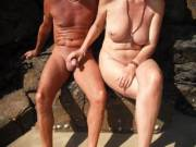 Playing with our nudist friend's cock at the local nude beach when it was quiet