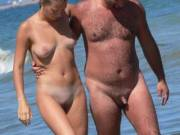 Us on the nude beach.  Anyone want to help satisfy her?