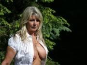 MILF baring her big tits