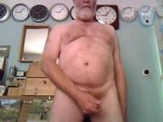 Performing on webcam in room full of clocks masturbating to double cumshot