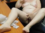 Naughty secretary putting on a seductive show