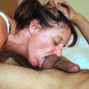 Mature 54 year young hotwife servicing the balls and rimming a man half her age.