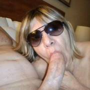For the August SUNGLASSES themed contest, here is my hotwife sucking her boyfriend's huge cock! I photographed all the action as he fucked her mouth and pussy? Do you think she is a good cocksucker?