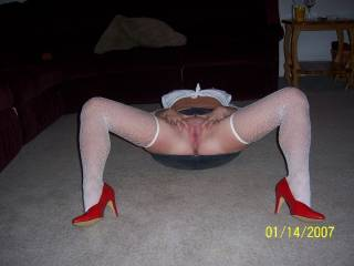 VEry nice, love those long legs and red heels and thigh highs and mini skirt with no panties. Very erotic lookking