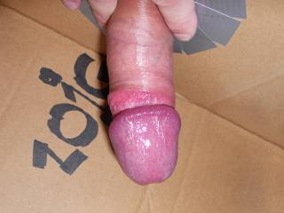Skin rolled back and sticky precum all over the glanse. Do you wanna suck it off?