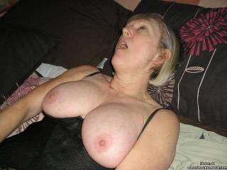 Very nice tits, love to lick them and she can have my cock to try for orgasms!