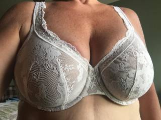 You can leave it on. Seeing sexy tits in a sexy bra is always a turn-on for me...