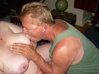 Sucking her tits