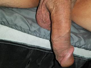 Hanging off the side of the bed