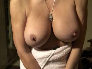 My wife's big tits fresh out of the shower. It's your turn, how would you use them?
