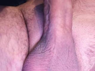 Laying down with my dick hard ready to be serviced.