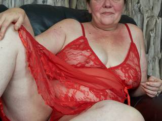 anita in her sexy red outfit