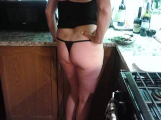 My sexy wife chillin in the kitchen before a little playtime