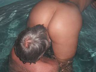 Our swinger friend eats out my pussy in the spa at home, when he came around again for a threesome.
