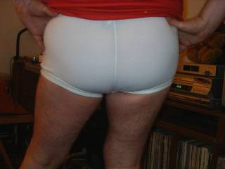 I love showing my ass off in my tight white football shorts just as I do showing it bare, it turns me on knowing people are ogling my ass!!!