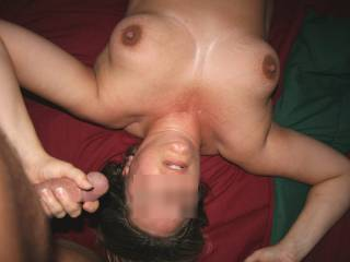 I'd prefer to have her jerk me off on her exquisite tits and my white hot cum splashes on her dark nipples