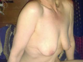 Wife posing naked for you.