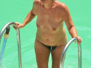 Wife at the pool wearing only a cap for everyone to see