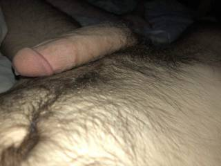 A bead of precum dripping from my hard cock