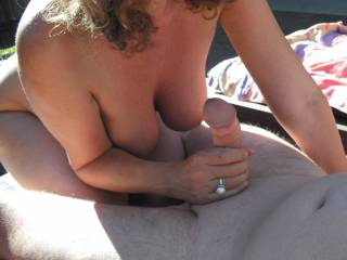 She came over whilst I was sunbathing by our pool and played with my cock.