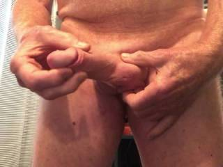 Squeezing my balls and jerking my cock.