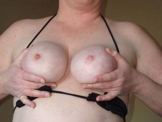 oooh yeah would love to slide my cock between those round firm tities and fuck them till i shoot my load on those little button nipples of hers