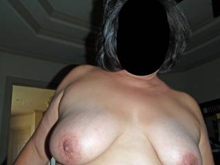 I'm stroking cock off camera in this pic!  Would you play with my tits and suck on my nipples if I stroked your cock?