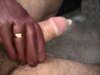 wife giving me a leather gloved condom handjob