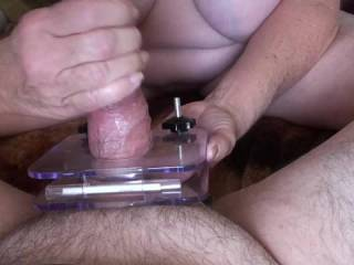 Part 2 of a 3 part video. I put Boyfriends balls in between these 2 acrylic pieces and tightened the screws down. Put Lube on his hard cock and started giving him a hand job . Do you have and use one of these? If not would you try it?