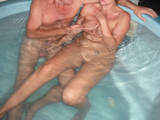 Mrs Oz plays with our swinger friends cock in the spa, when they came around for a play.