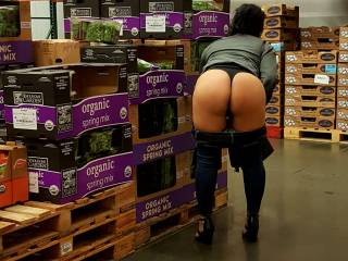 She was hot in the cold box so she pulled her pants down for some fresh air... and per my request of course.  What would you do if you saw that big round ass exposed in your local vegetable cold box?