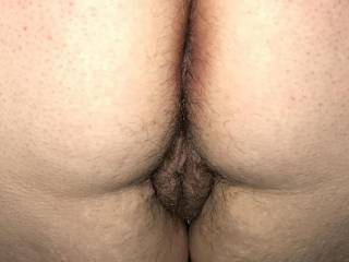 Kiki bending over showing me her hairy pussy lips.