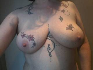Sally just out of the shower, showing off her tattoos and proud to show her tits!
