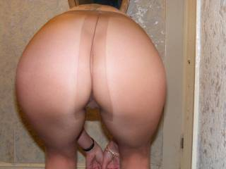 I just want to shoot a load all over her sexy nylon arse.