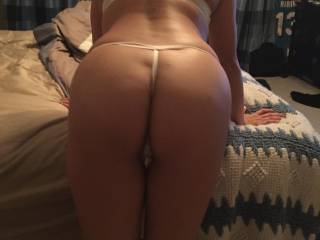 Do you like my hot wife's new thong ?  And what do you want to do to her ?