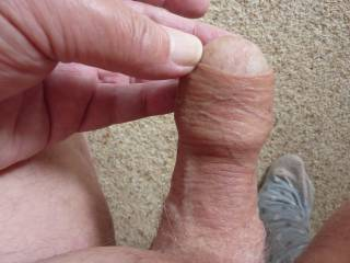 showing my max coverage when holding my foreskin,if i take my hand away it will slip straight back