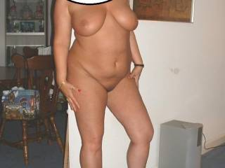 She is beautiful, love those big tits and smooth pussy.