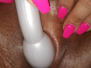 Doesn\'t her nails look good with that toy on her clit?