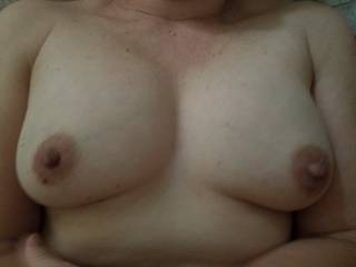 I think a nice big shot of cum would look perfect on those tits