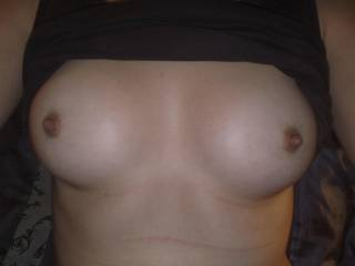 Lovely nipples.  I'd like to cum on her and suck her pussy