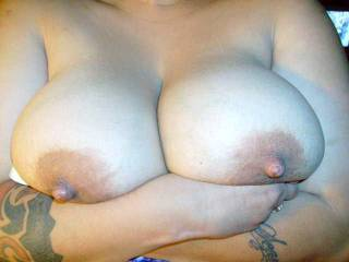 my old ladys aswesome tits...her boobs and nipples are huge and soft.what wuold you like to do to butterscotchs tits,for her?