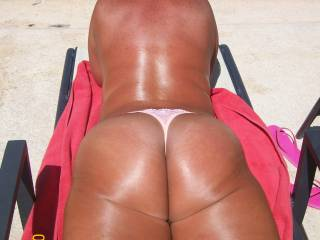 OMG!!  You have the most gorgeous sexy ass and lusciously sexy legs I have seen!!  You look extremely good to me!  Love to be there rubbing you down with suntan oil and so much more!!  Love those legs and butt Baby!!